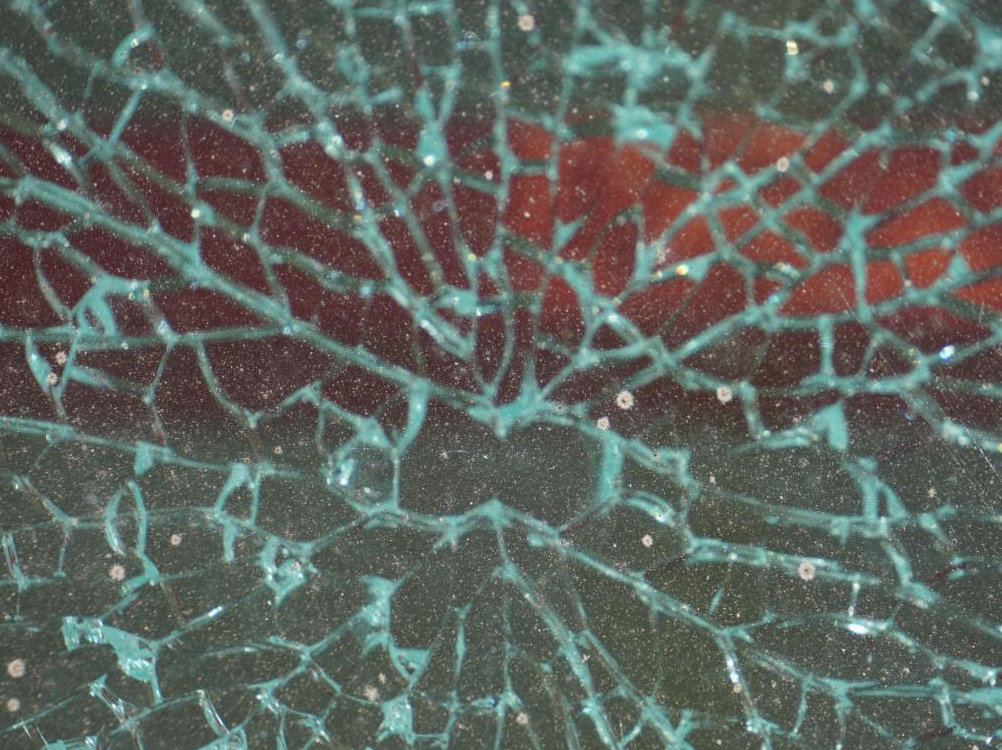Toughened glass fracture origin showing butterfly pattern