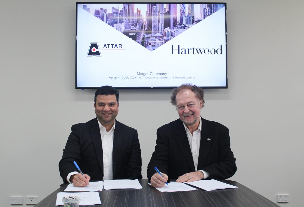 ATTAR and Hartwood Consulting signing the agreement
